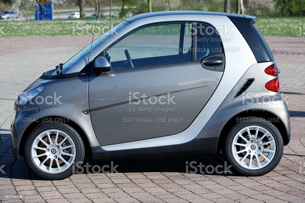 Smart car sideview in public parking area stock photo