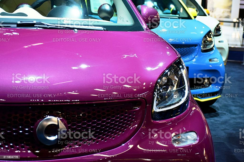 Smart cars in a row stock photo