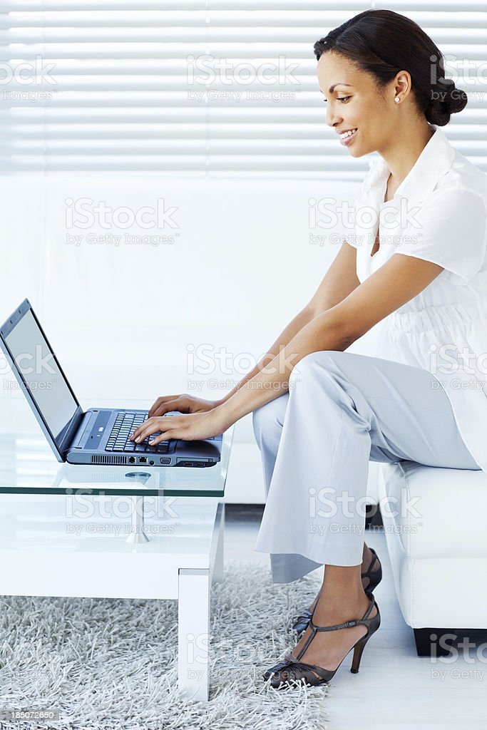 Smart Casual Businesswoman Using Laptop royalty-free stock photo