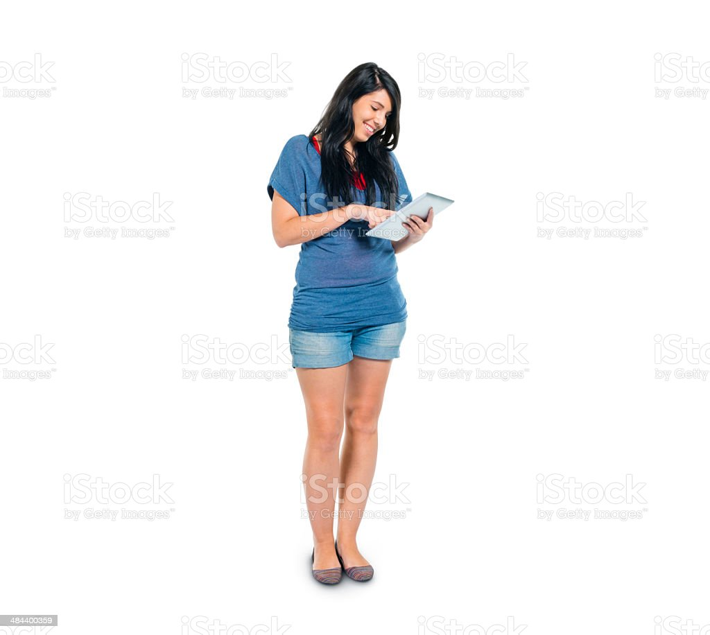 Smart Casual Girl Using her Digital Tablet while Standing stock photo