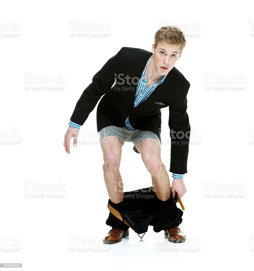 Smart casual man caught with his pants down stock photo
