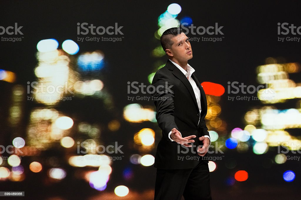 Smart casual man gesturing outdoors stock photo