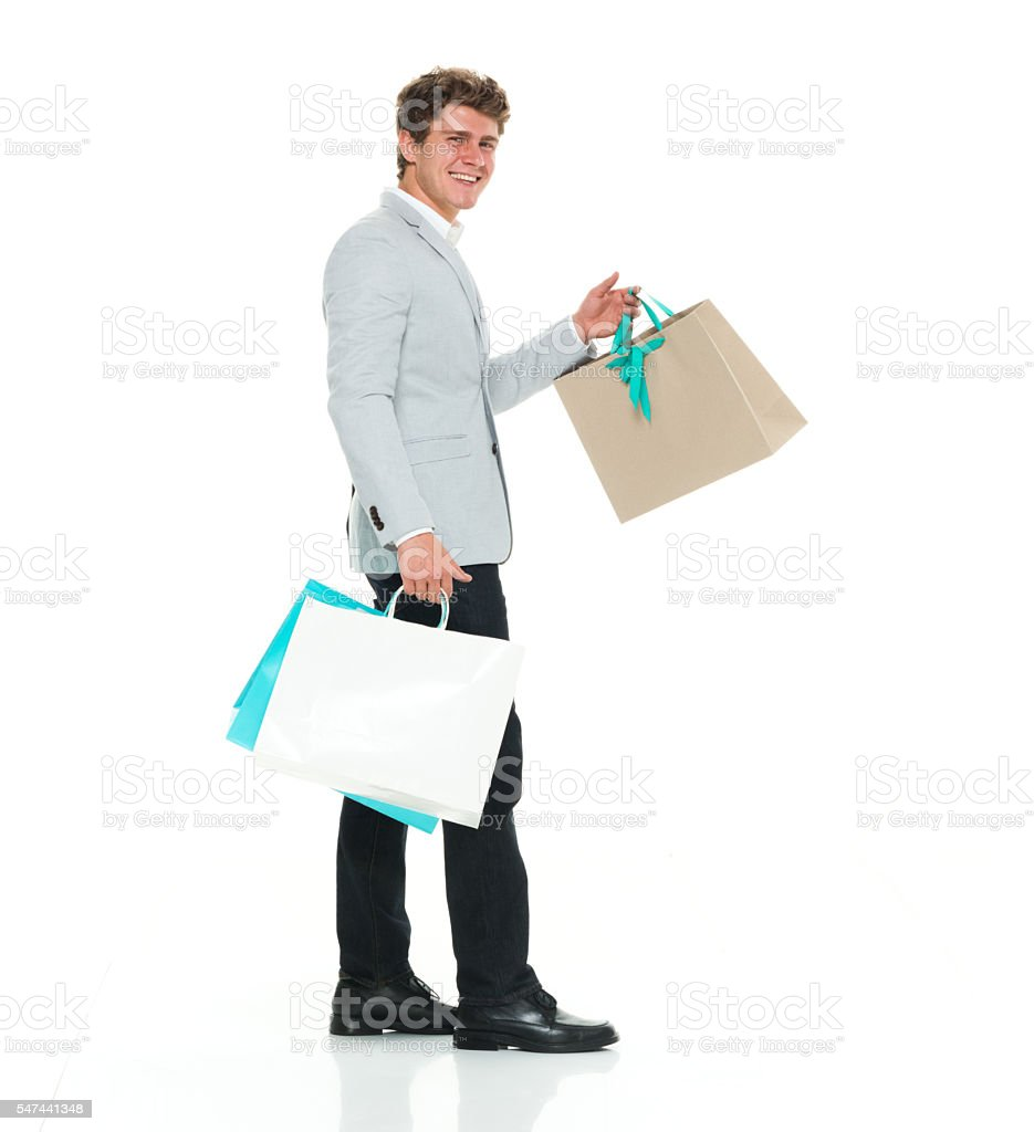 Smart casual man holding shopping bag stock photo
