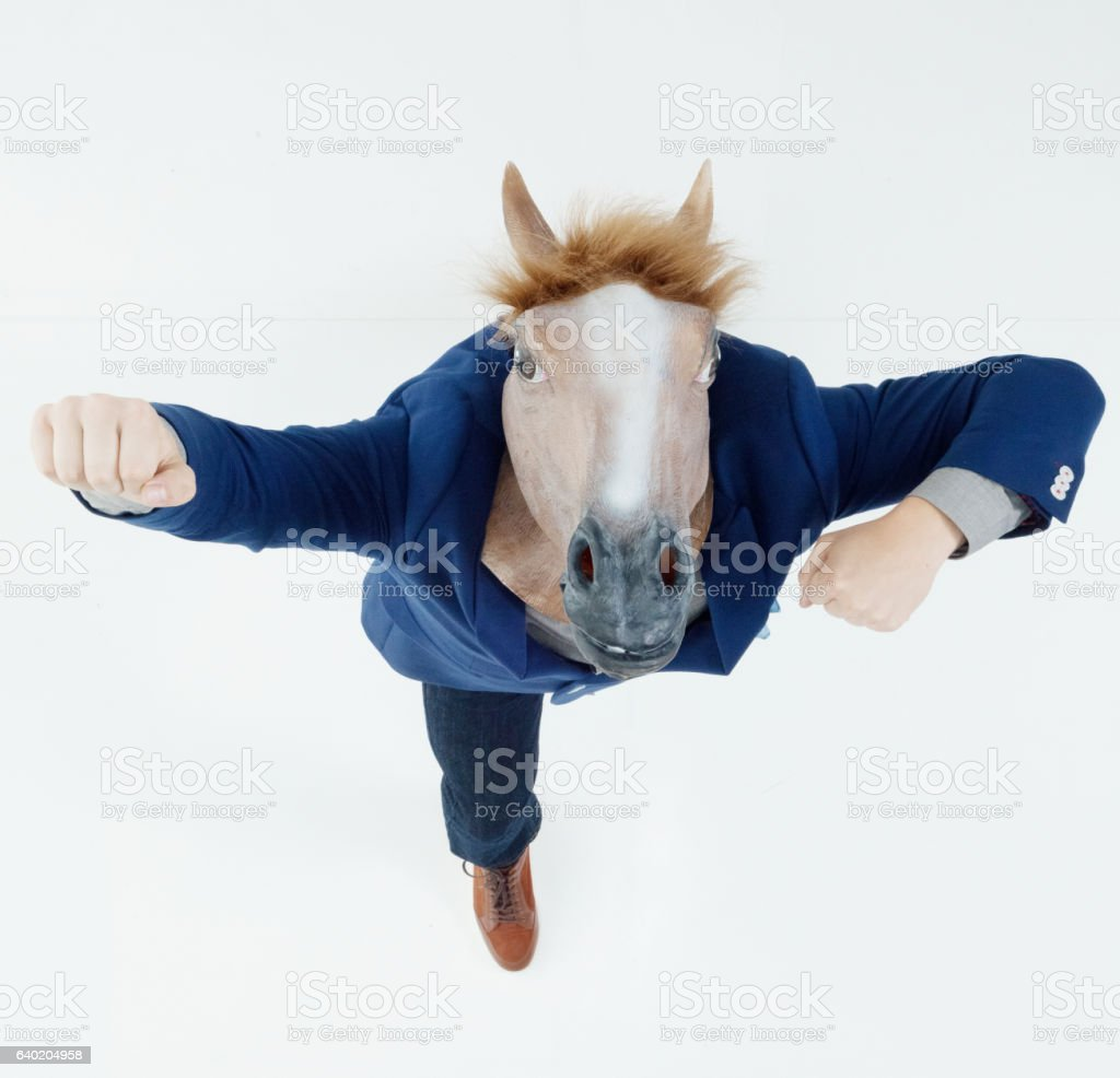 Smart casual man in horse costume cheering stock photo