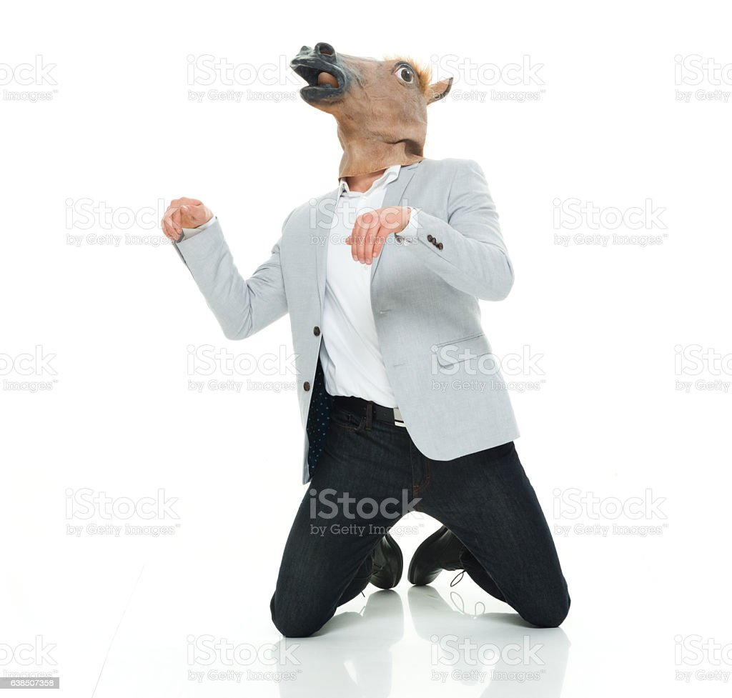 Smart casual man in horse costume stock photo