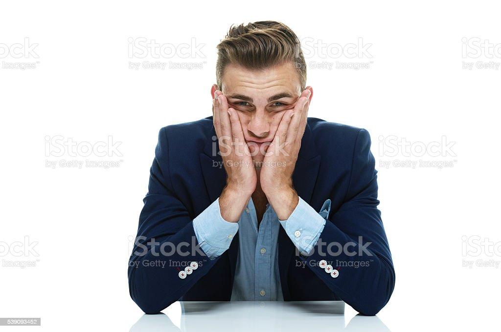 Smart casual man looking upset stock photo