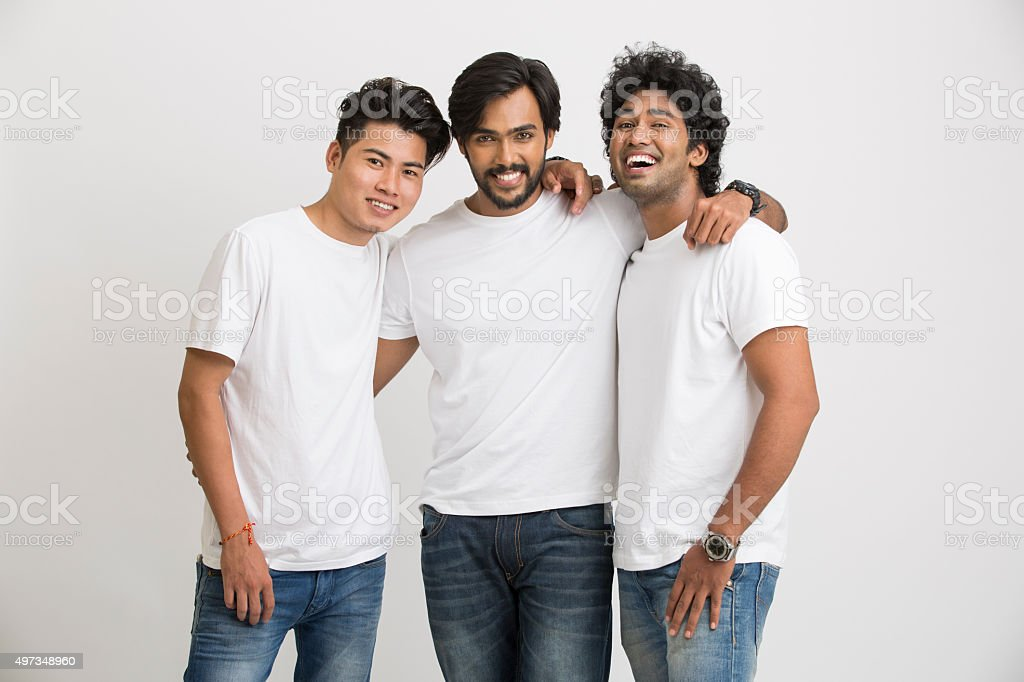 Smart cheerful indian young male friends laughing stock photo