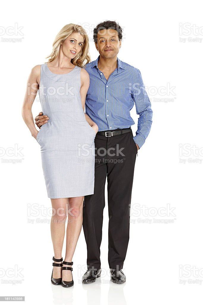 Smart couple standing together over white background royalty-free stock photo