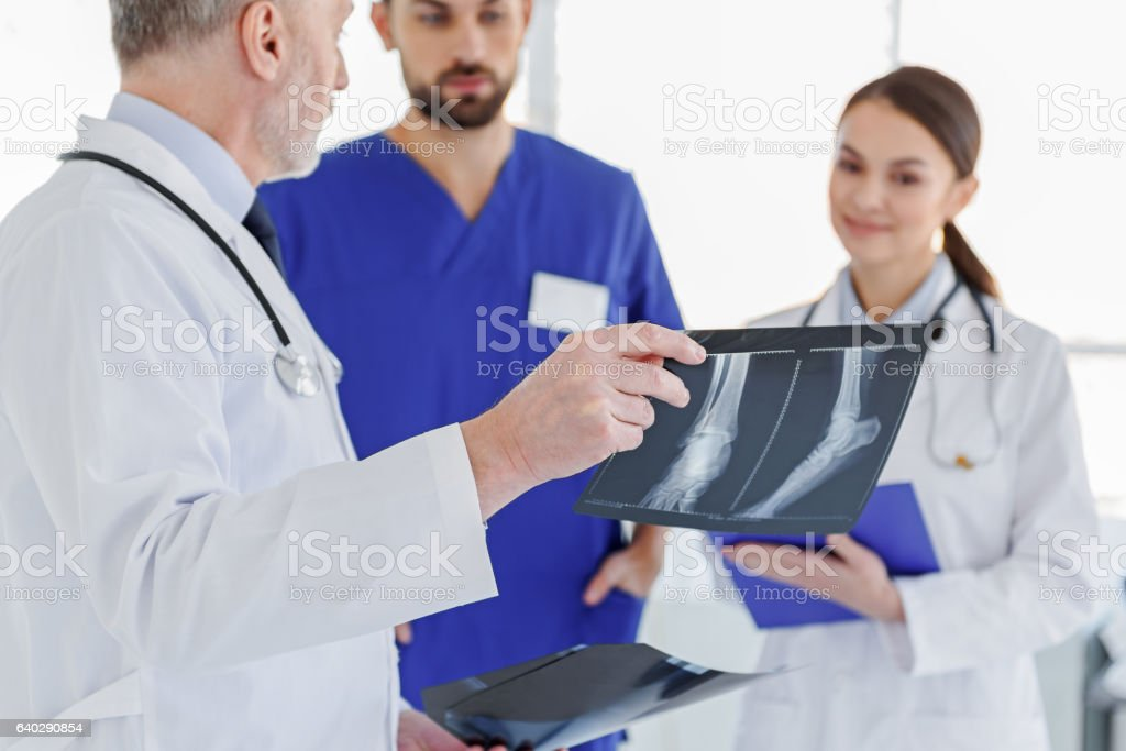 Smart doctors discussing x-ray photo stock photo