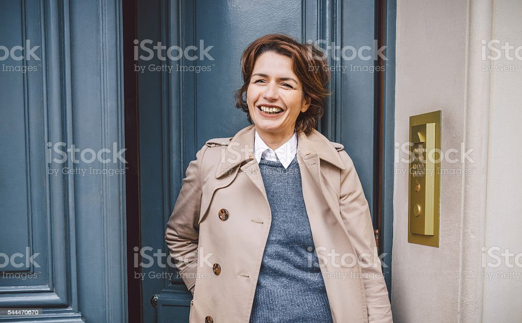Smart fashionable woman stepping outdoors stock photo
