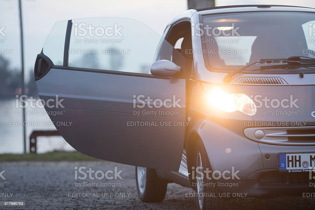 Smart fortwo cabrio front light at dusk outdoors stock photo