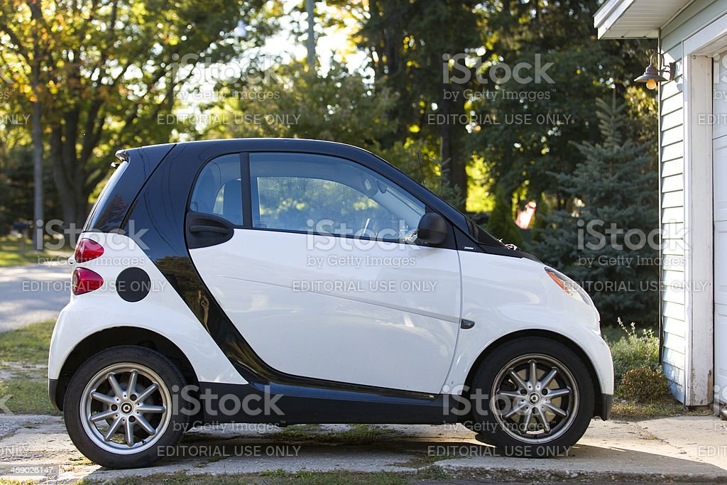 Smart Fourtwo Passion Coupe parked in driveway royalty-free stock photo