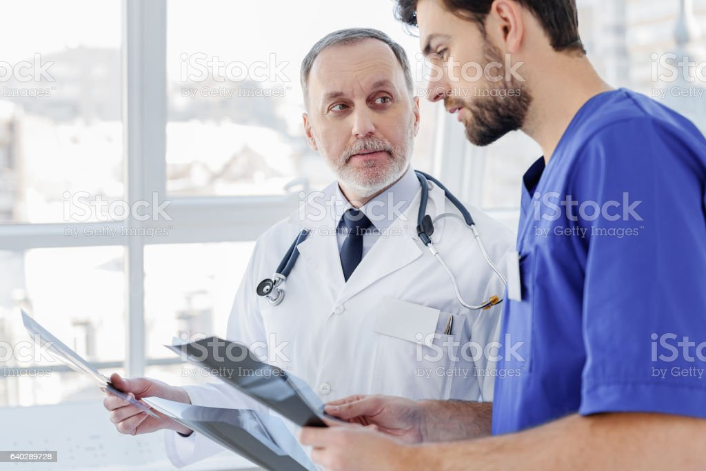 Smart future general practitioner sharing his point of view stock photo