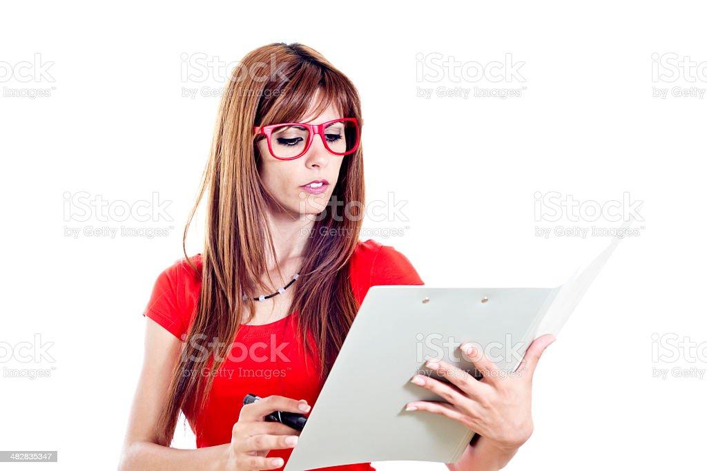 Niña inteligente con gafas y carpeta foto de stock libre de derechos