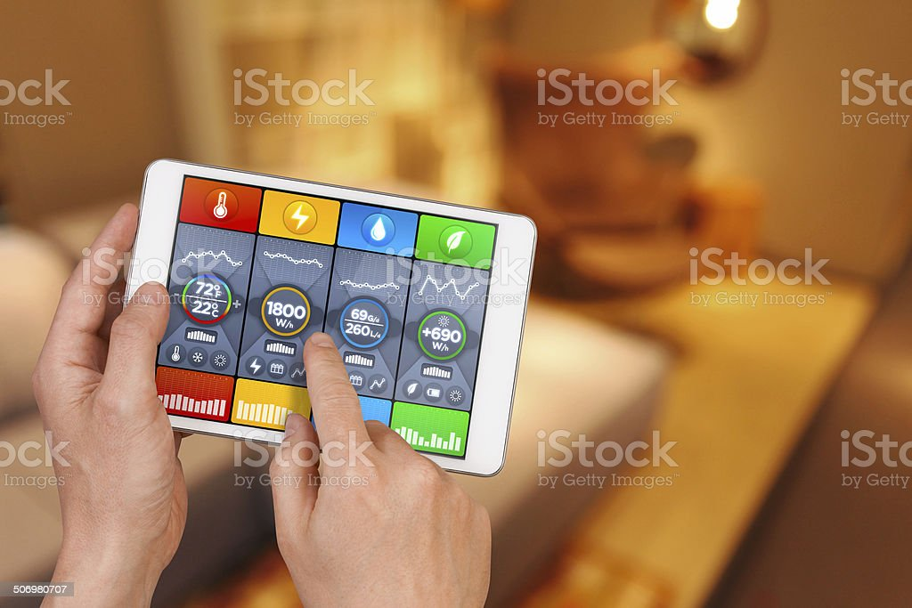 Smart home automation: controlling house temperature, water, green energy consumption stock photo