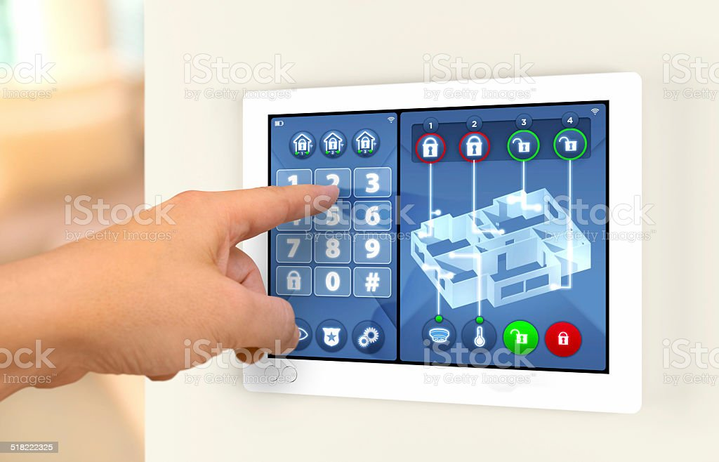 Smart home automation: engaging house alarm security system stock photo