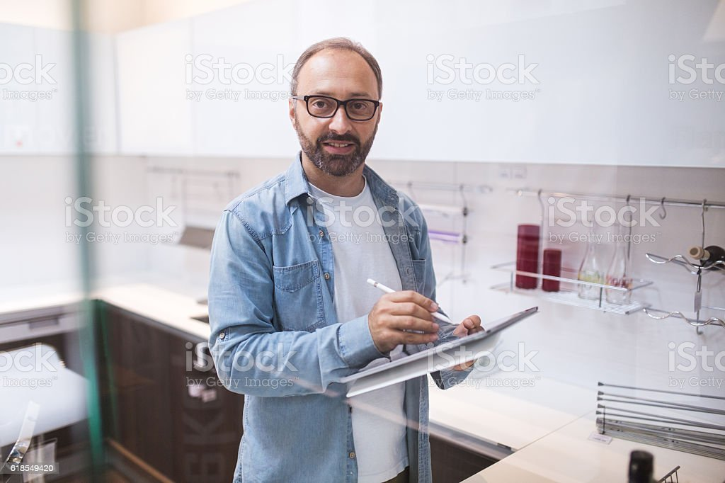 Smart home automation in kitchen with tablet and app stock photo