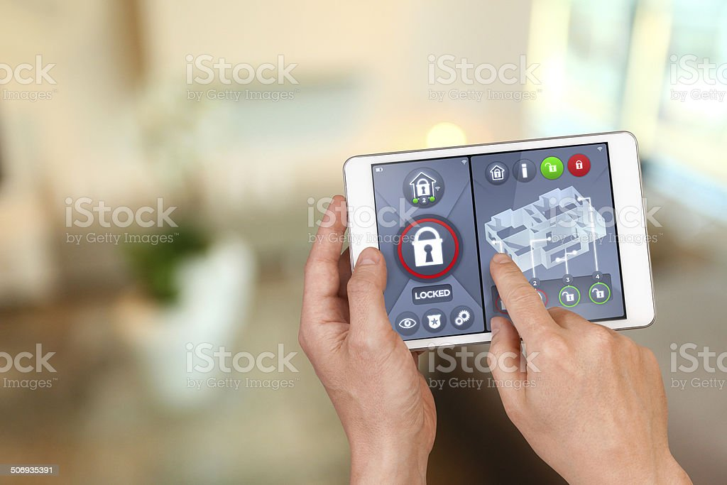 Smart home automation: locking house doors with security remote control stock photo