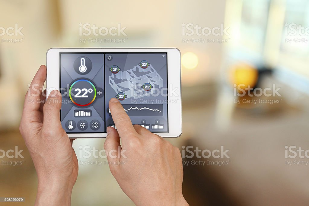 Smart home automation: remote controlling house temperature, Celsius degrees stock photo