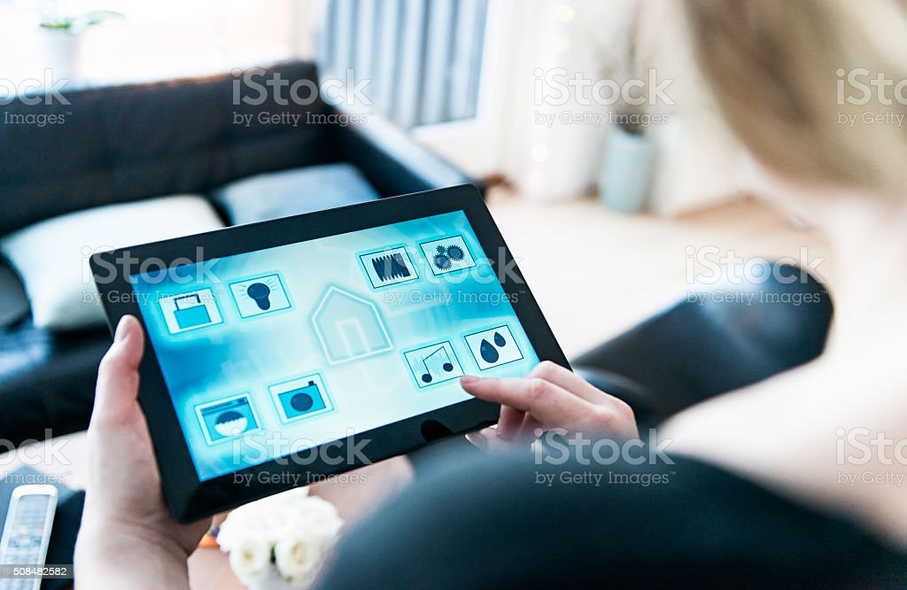 Smart home automation with tablet and app stock photo