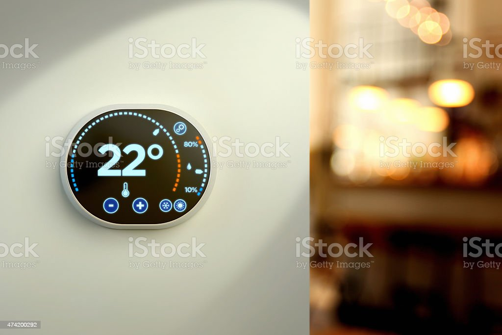 Smart home climate control system: Celsius temperature wall display stock photo