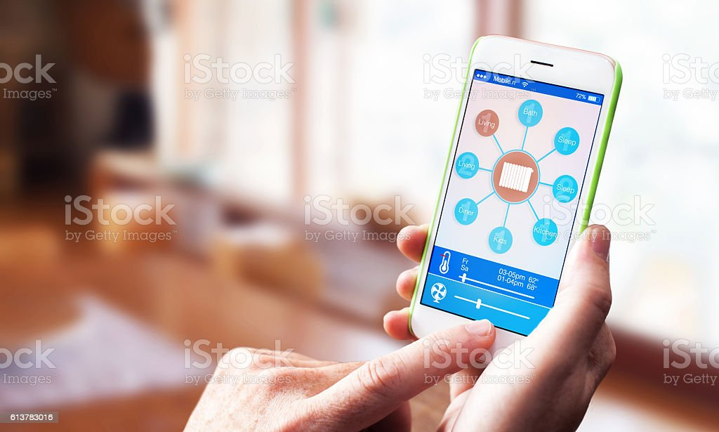 smart home house control app on smartphone stock photo