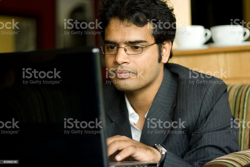 Smart Indian business man working on computer royalty-free stock photo