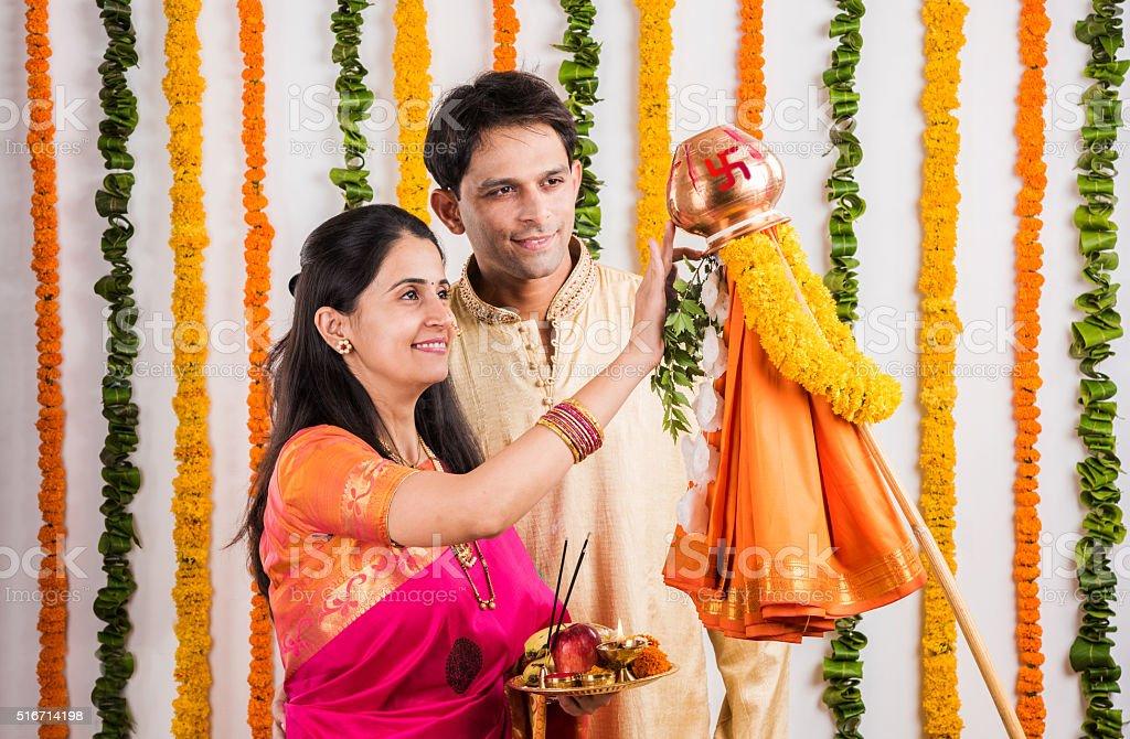 smart indian couple performing gudhi padwa puja stock photo
