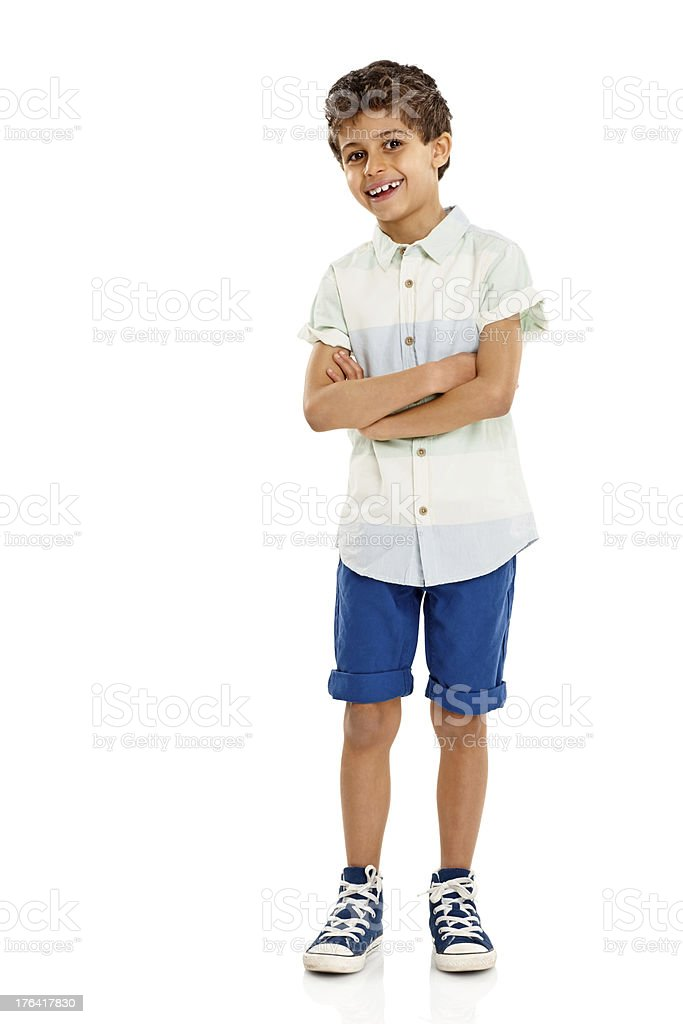Smart little boy standing confidently on white stock photo