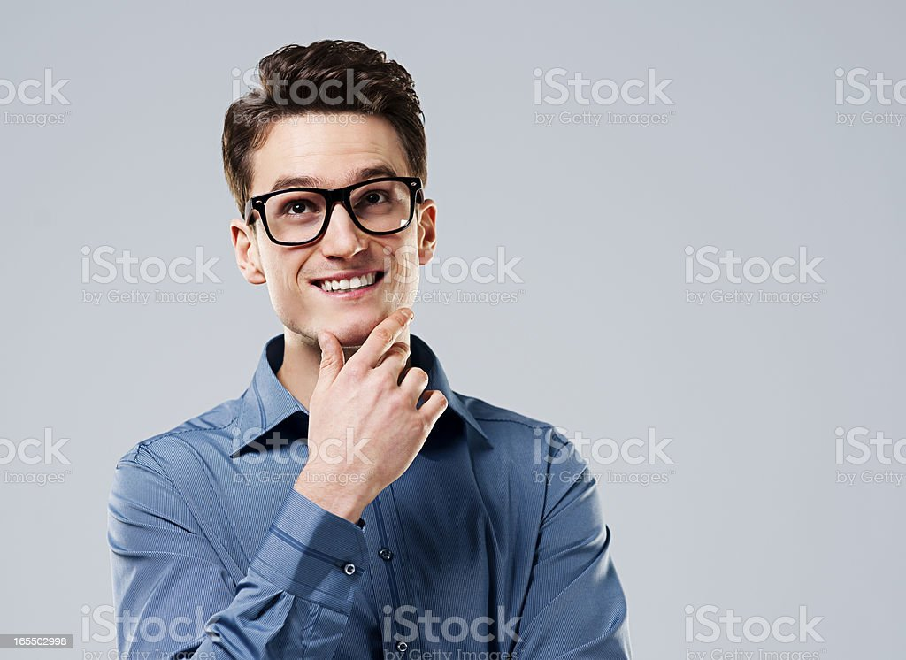Smart man with glasses looking up royalty-free stock photo