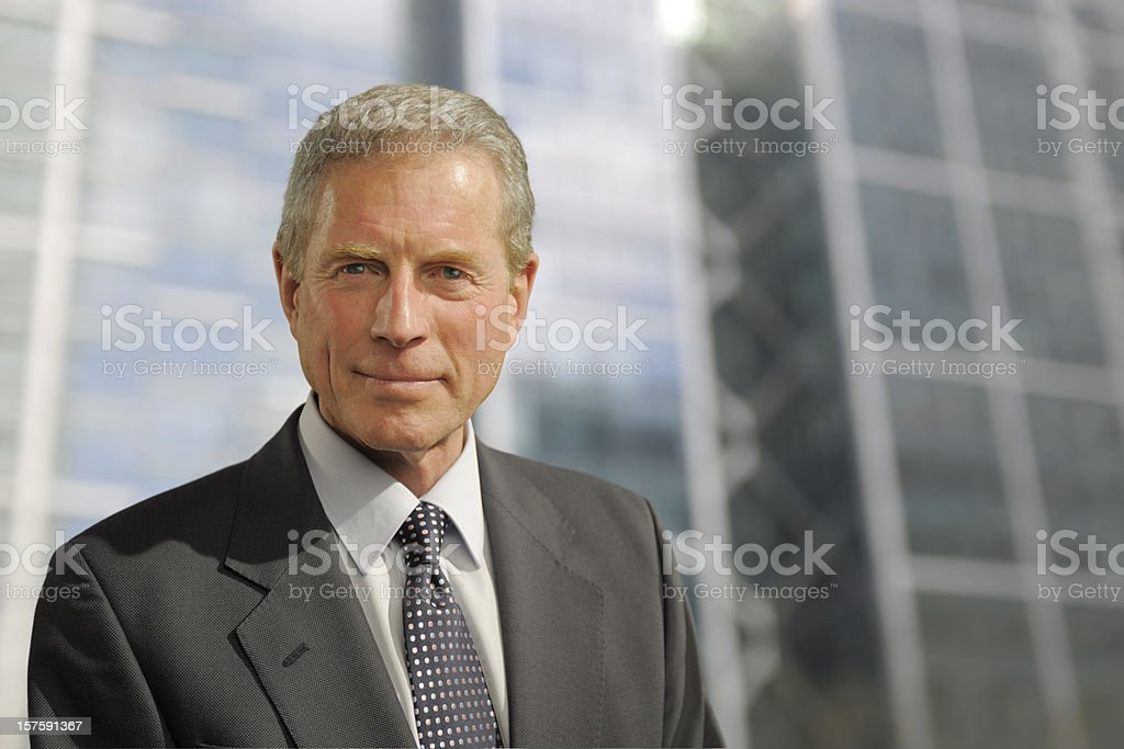 smart mature businessman in city stock photo