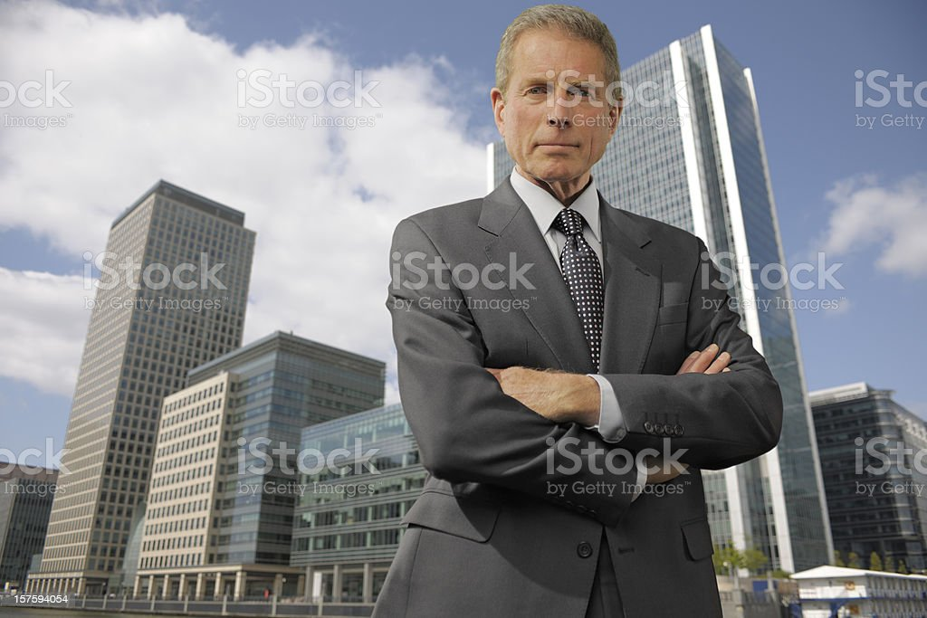 smart mature businessman in city royalty-free stock photo