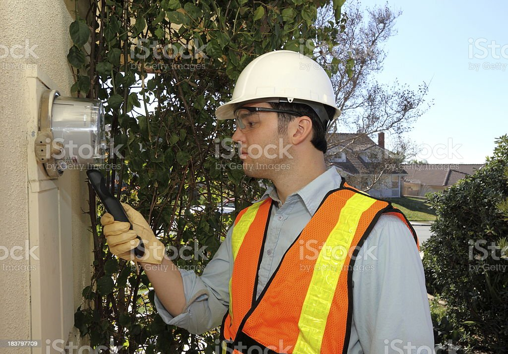 Smart Meter Technician Calibrates Device stock photo