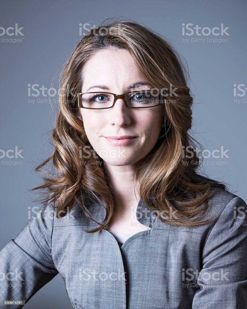 Smart mid adult Caucasian business woman stock photo
