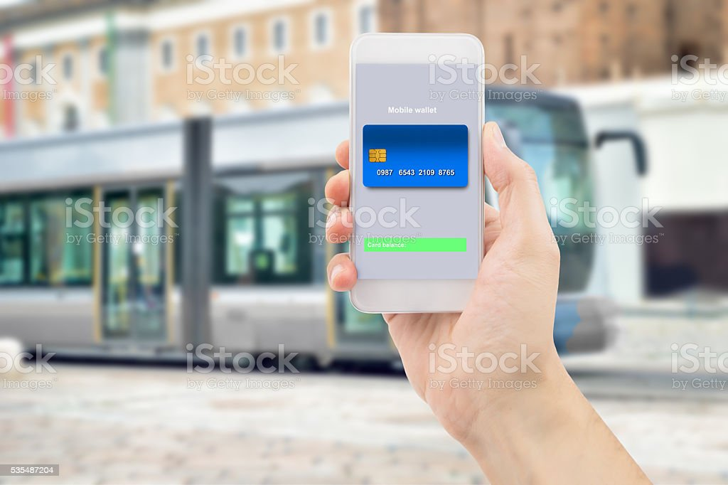 smart mobile with wallet from tram stock photo