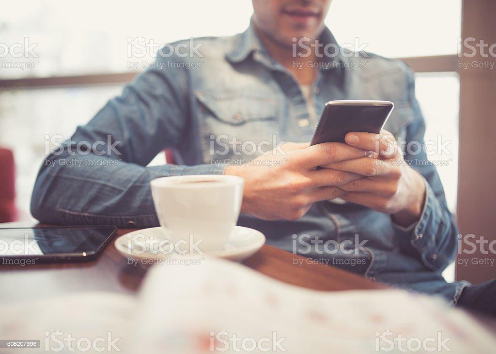 Smart phone and coffee stock photo