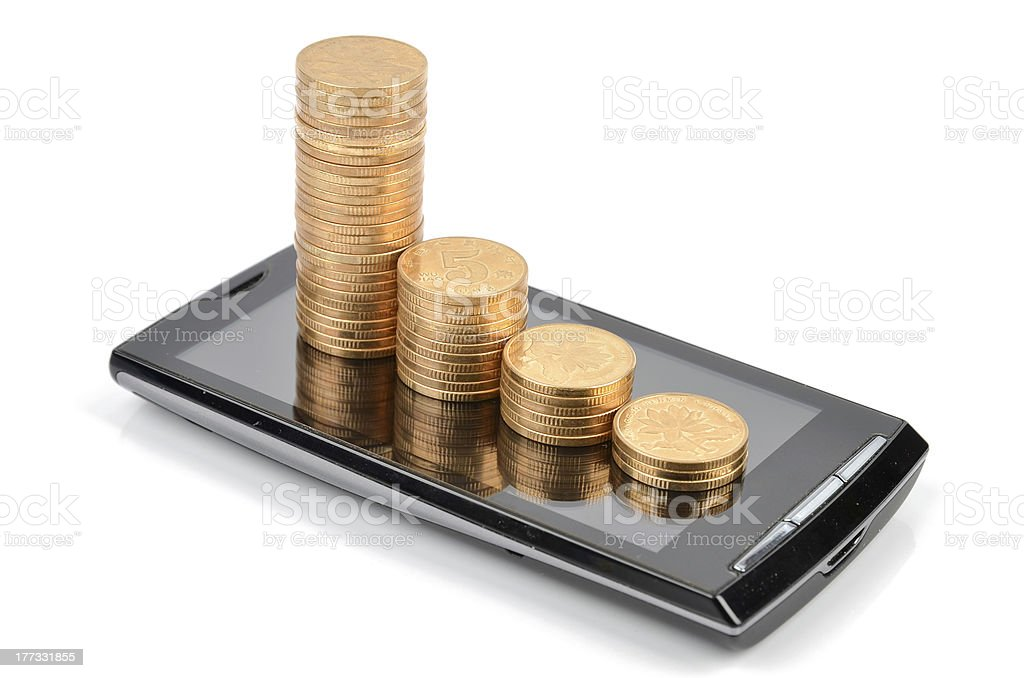 Smart phone and coin stock photo