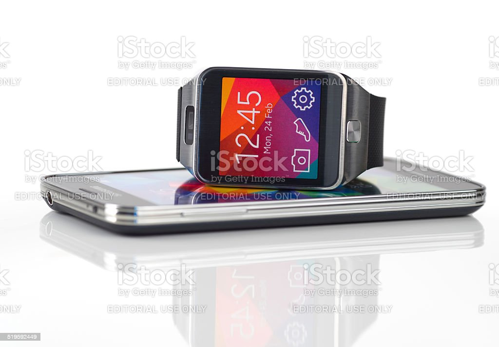 Samsung Galaxy Smartphone and Galaxy Gear Smartwatch on white stock photo