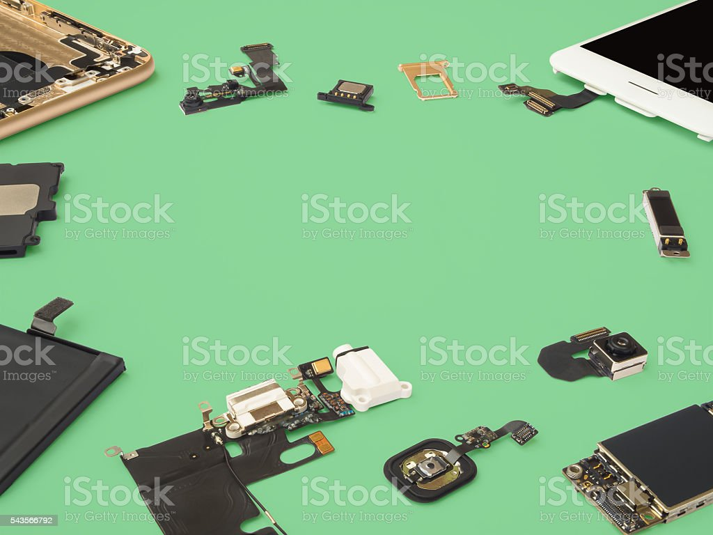 Smart phone components isolate on green background stock photo
