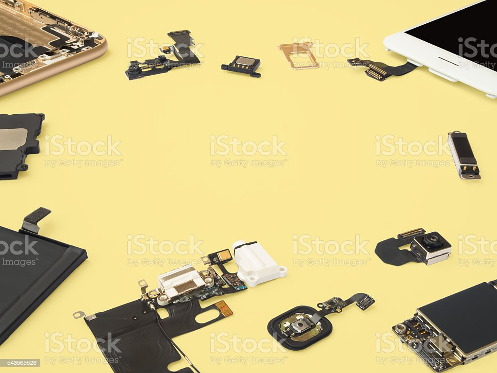 Smart phone components isolate on yellow background stock photo