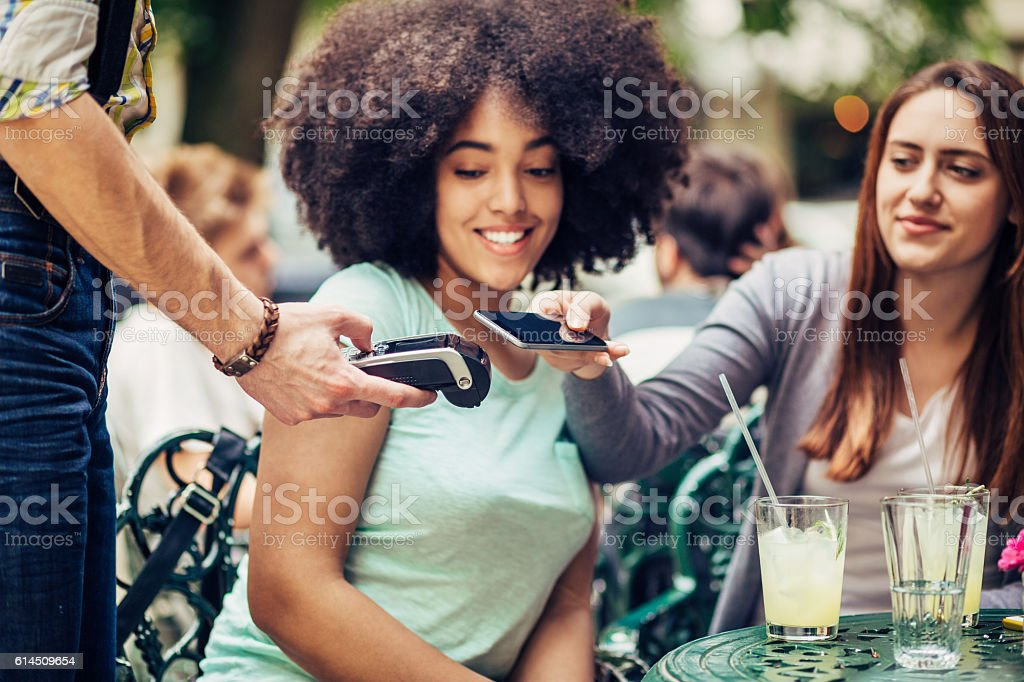 Smart phone contactless payment stock photo