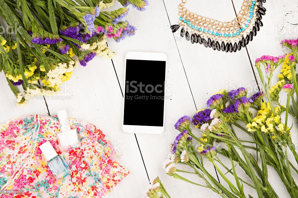 smart phone, dress, colorful flowers, cosmetics makeup, bijou stock photo