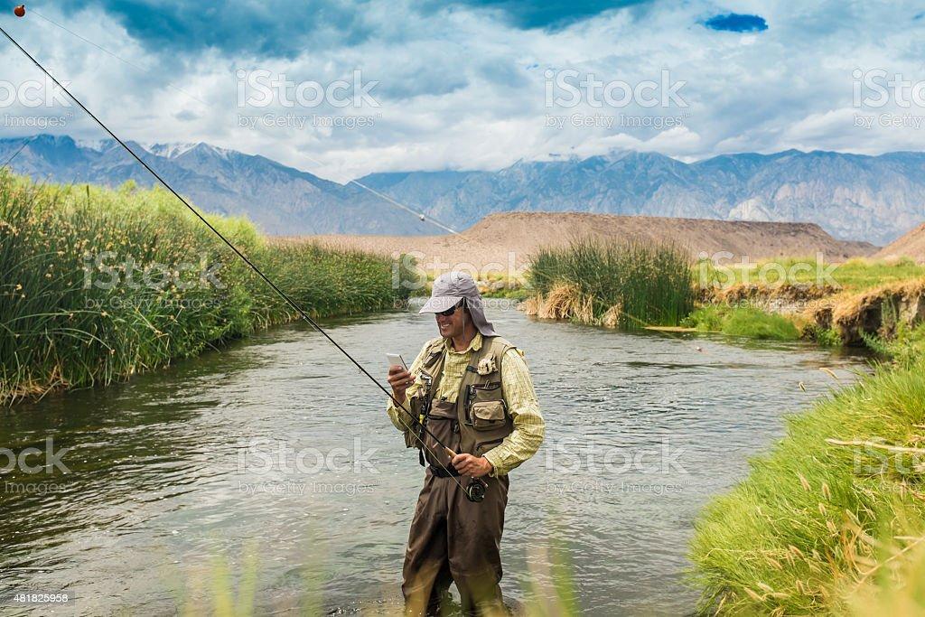 Smart Phone Fisherman stock photo