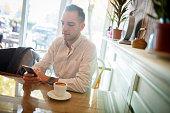 Smart phone in coffee shop