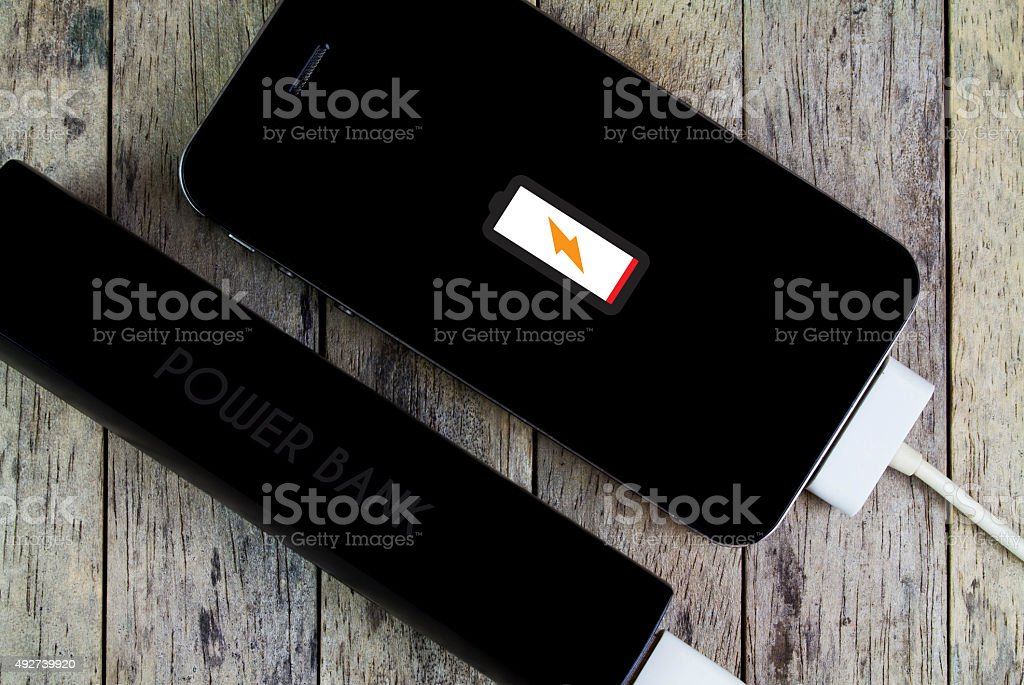 smart phone is charging with power bank stock photo