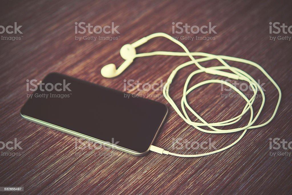 smart phone mobile phone and headphones stock photo