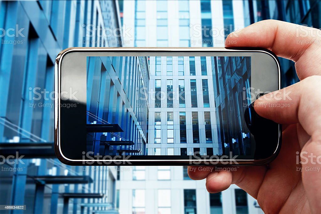 Smart phone mobile photo with office building stock photo