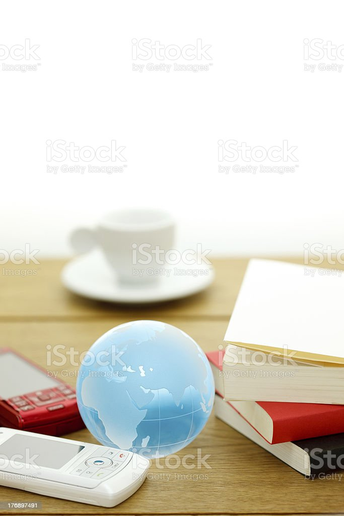 Smart phone, mobile tool, book, and the earth royalty-free stock photo
