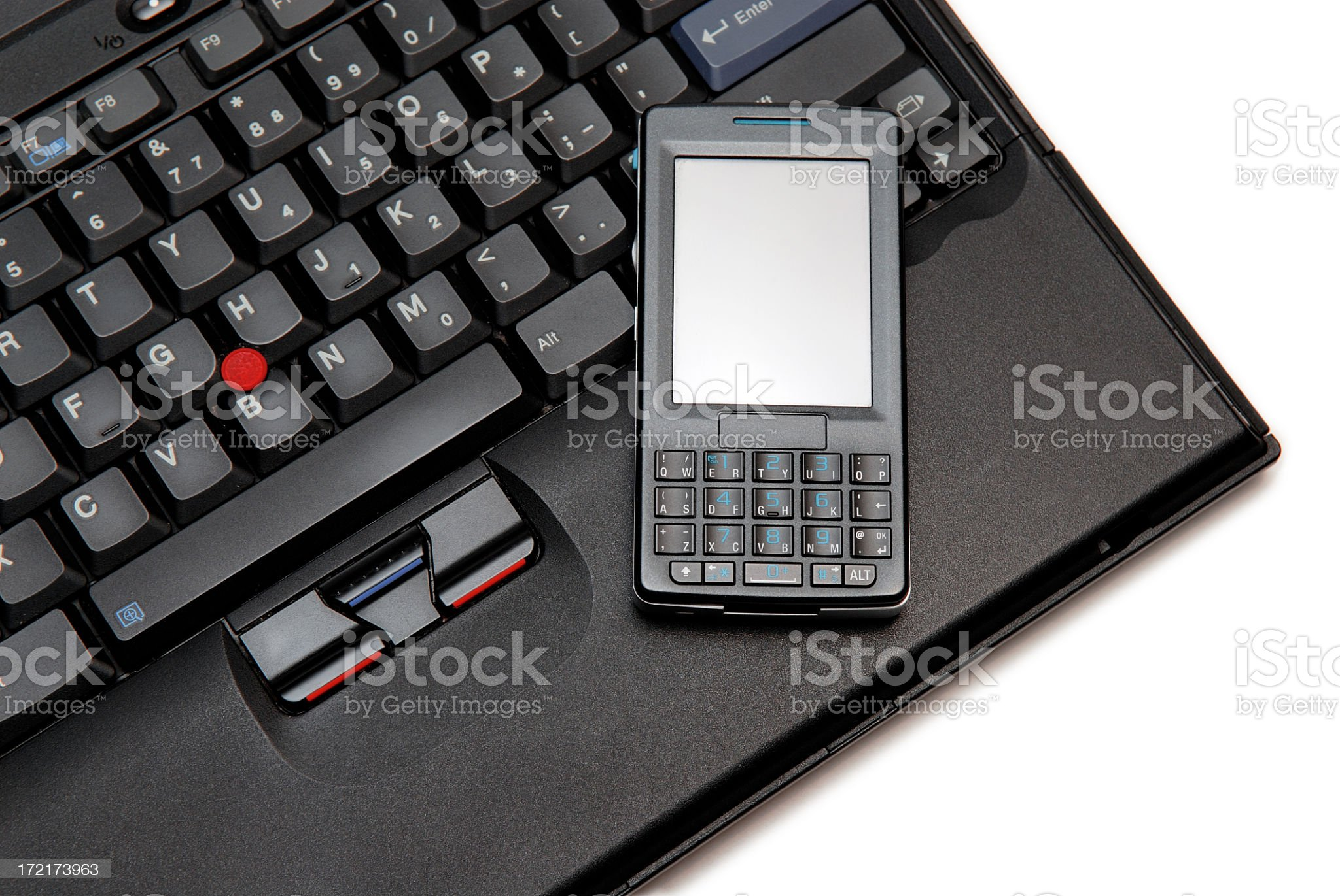 Smart Phone on a Laptop royalty-free stock photo