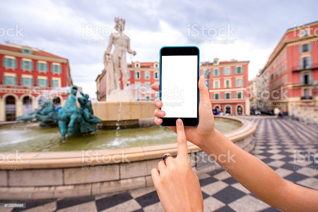 Smart phone on Nice city background stock photo